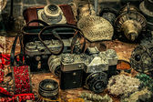 Old postcards with old photo cameras and different antiques — Stock Photo