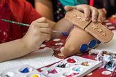 Children painting pottery 19 — Stockfoto