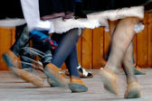 Abstract blurred motion feet of dancers — Stock Photo