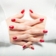 Woman showing her red nails, manicure — Stock Photo #63982147