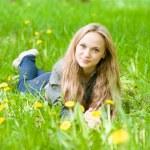Portrait beautiful girl lying on the grass  — Stock Photo #73975431