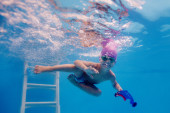 Little boy trains in the pool — Stock Photo