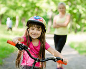 Mom and daughter ride bikes — Stock Photo