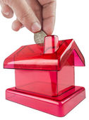 Red house shaped piggy — Stock Photo
