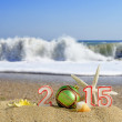 New year 2015 sign with seashells, starfish and christmas ball on a beach sand — Foto de Stock   #60597705
