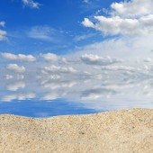 Beach background with a heap of sand on a background of sky. Ready for product display montage — Stok fotoğraf