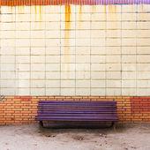 Purple bench near the wall — Stock Photo