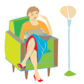 Woman reading on armchair — Stock Photo