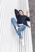 Beautiful young female lying on a park bench — Stock Photo