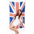 Young woman having fun next the Union Jack flag — Stock Photo #57542305