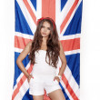 Young woman having fun next the Union Jack flag — Stock Photo #57542313