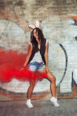 Sexy girl in pink rabbit ears dancing  with red smoke bombs — Zdjęcie stockowe