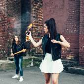 Two Bad girls with Molotov cocktail bomb in the street — Stock Photo