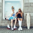 Two friends using their smart phones outdoors — Стоковое фото #79435164