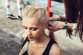 One girl while another pulling her long plait — Stock Photo
