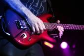 Guitar player with electric guitar — Stock Photo
