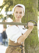 Woman in medieval dress with sword — Stock Photo