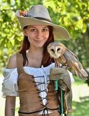 Pirate woman with an owl — Stock Photo