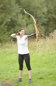 Young woman training with the bow — Stock Photo