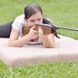 Girl aiming a pneumatic rifle — Stock Photo #53166455
