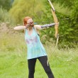 Young women training with the bow — Stock Photo #53168855
