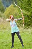 Young women training with the bow — Stock Photo