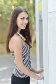 Young beautiful woman at ATM — Stockfoto