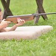 Girl aiming a pneumatic rifle — Stock Photo #53394561