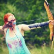 Young women training with the bow — Stock Photo #53394793