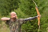 Young man training with the bow — Stock Photo