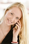 Sexy blonde girl with phone — Stockfoto