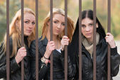 Girls behind bars — Stockfoto