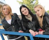 Girls posing on steps — Stock Photo