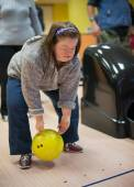 Woman with down syndrome at bowling — Stock Photo