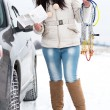 Woman putting winter tire chains on car — Foto Stock #61822783