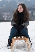 Woman having fun on snow sledge — Stock Photo