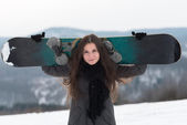 Young girl with snowboard — Stock Photo