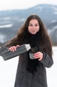 Girl drinking hot tea in the winter — Stock Photo