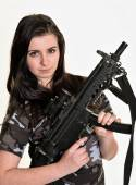 Beautiful woman with gun — Stock Photo