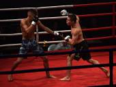 Strong fighter and his opponent during a fight in a ring Combat Fight Night — Stock Photo