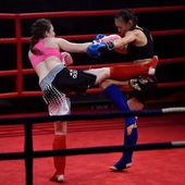 Women fighters during a fight in a ring Combat Fight Night — Stock Photo