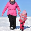 Mother and daughter nice winter scene — Stock Photo #65008311