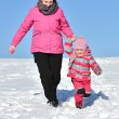 Mother and daughter nice winter scene — Stock Photo #65008341