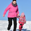 Mother and daughter nice winter scene — Stock Photo #65008353