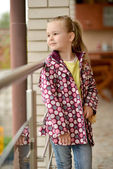 Little girl at porch — Stock Photo
