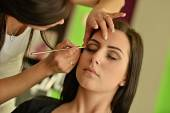 Make-up artist applying base color eyeshadow — Stock Photo