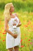 Pregnant woman with a doll — Stock Photo