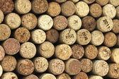 Muitas rolhas de vinho diferentes no fundo — Foto Stock