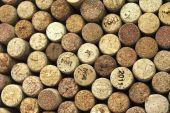 Muchos diferentes corchos de vino en el fondo — Foto de Stock