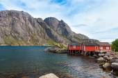 Typical red rorbu fishing hut in village Nusfjord — Stock Photo